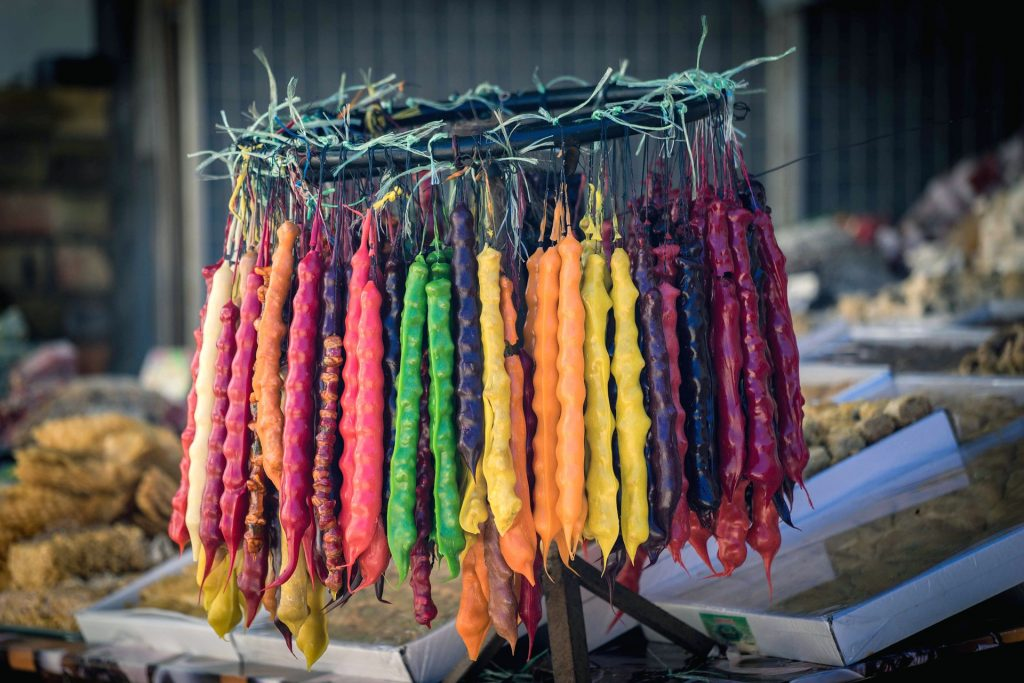Churchkhela (stringed nuts dipped in grape juice and flour/corn flour mixture and dried) in various colors, Tbilisi
