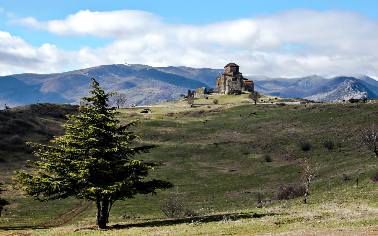 Jvari Church on top of the grassy hill