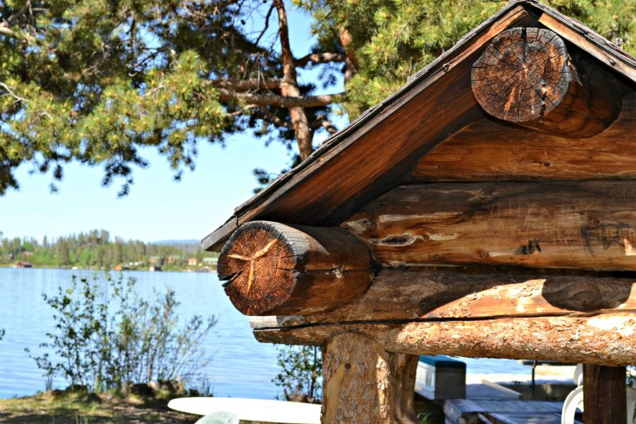 Log structure with Grand Lake in background