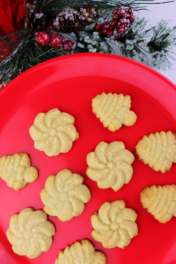 Keto butter spritz cookies on a red plate