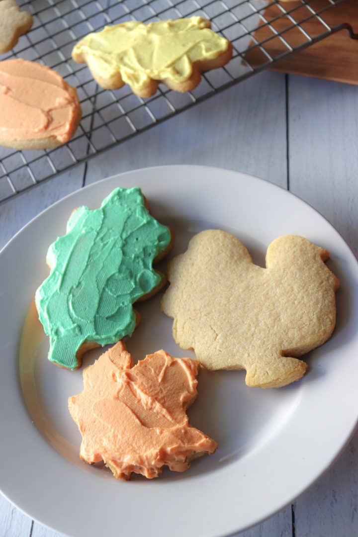 Three keto cut out sugar cookies on a plate