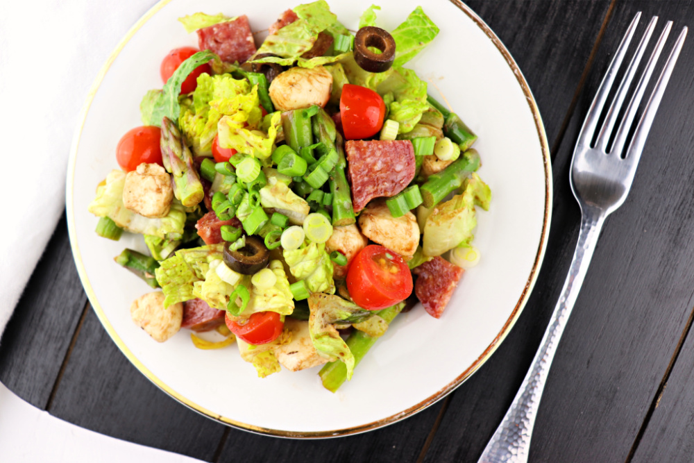 Antipasto Salad is full of flavor and a great keto or low carb lunch! Take it to your next picnic or potluck and voilà! The perfect gluten-free salad option. #ketolunch #lowcarbsalad