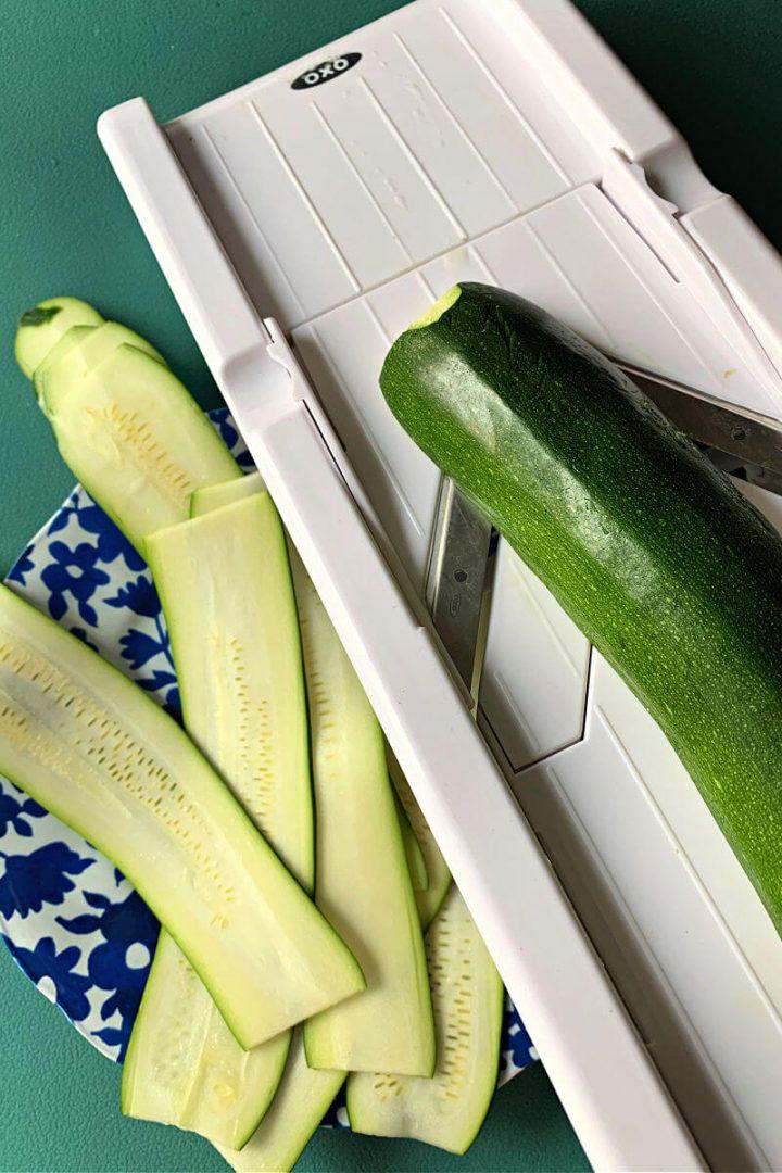 Mandolin and slices of zucchini