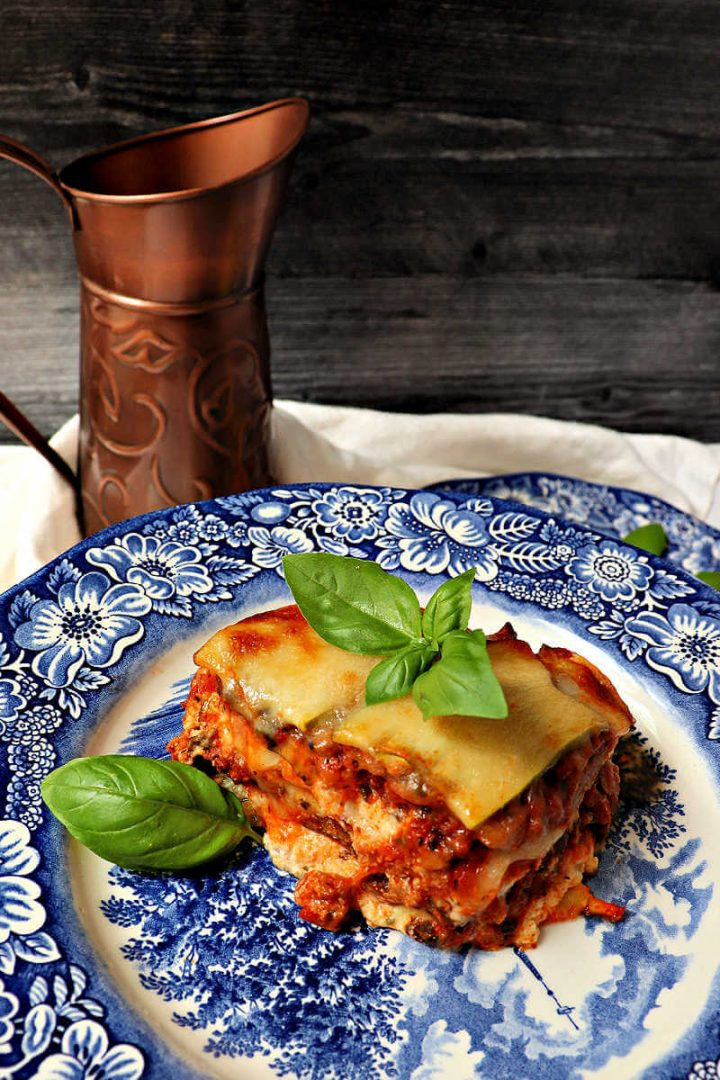 Piece of keto zucchini lasagna on a blue and white plate