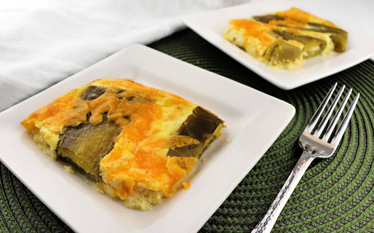 Keto Breakfast Casserole, chiles rellenos, two pieces on white square plates