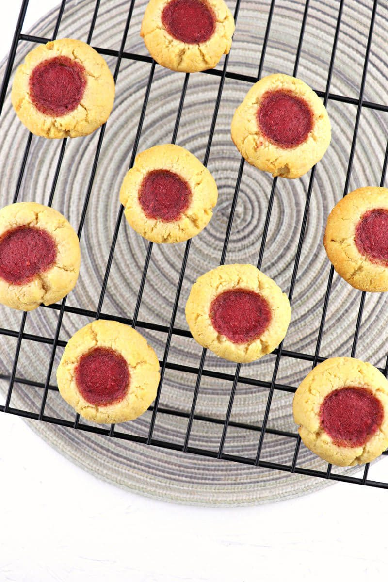 Traditional butter and jam thumbprint cookies are a low carb holiday staple! Christmas, Easter, or the Fourth of July, these kid-friendly gluten-free cookies will disappear fast. #ketocookies #lowcarbcookies