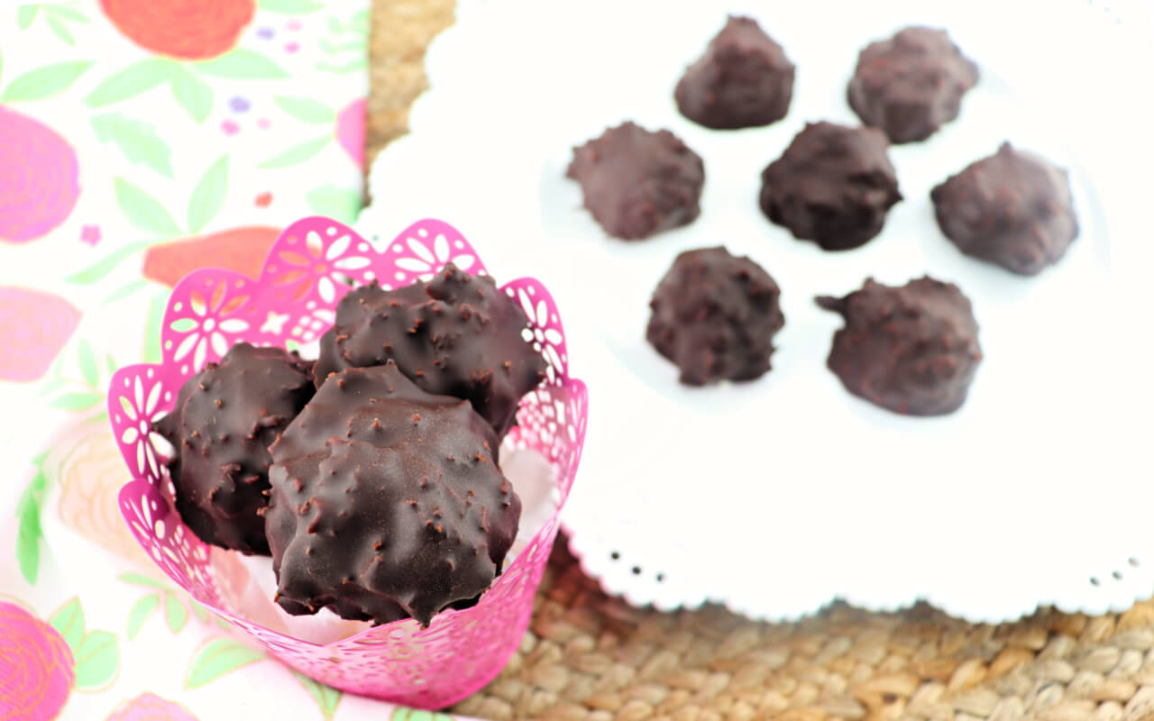 Easy keto chocolate coconut balls are the perfect candy treat to satisfy those cravings around Easter and other holidays. Gluten-free, sugar-free and low carb delicious. #ketocandy #lowcarbeaster