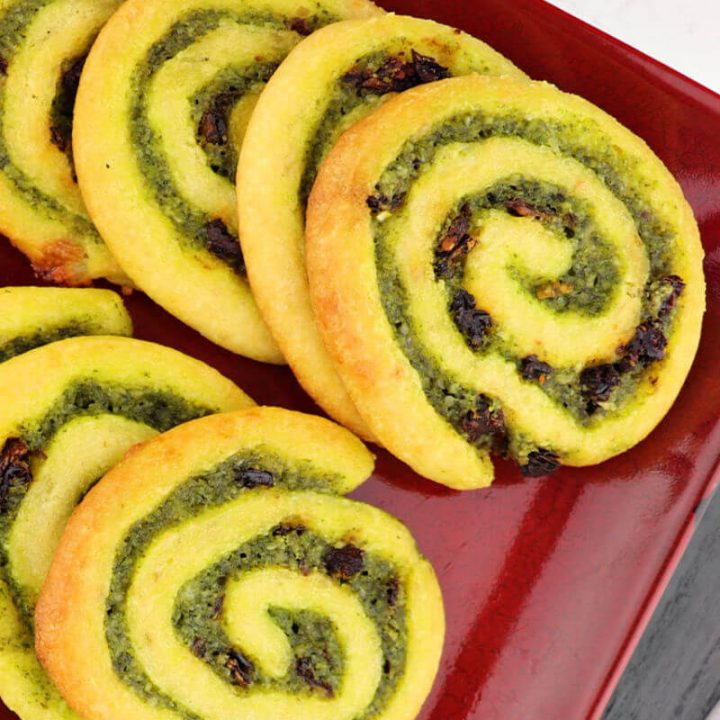 Keto pesto pinwheels are a fun and flavorful low carb snack. Perfect for parties and game days. #ketosnacks #ketorecipes