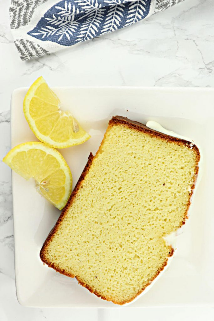 A piece of lemon keto pound cake is the perfect low carb breakfast or gluten-free dessert. #lowcarbdesserts #lowcarbdessertsketo