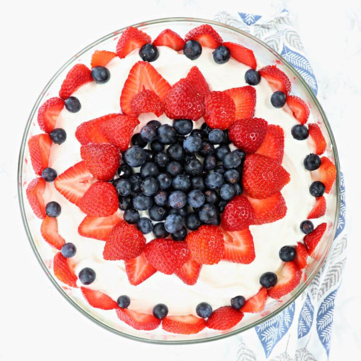 Delicious lemon pound cake, custard, cream and berries come together in keto berry trifle, the perfect centerpiece for Memorial Day, the Fourth of July, or any summer event. #ketodesserts #lowcarbdesserts
