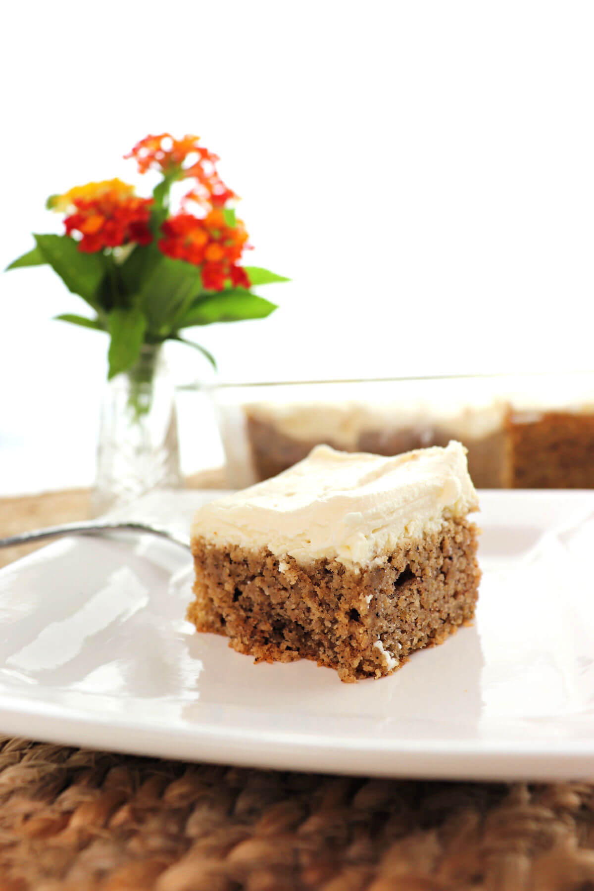 Low carb keto spice cake is packed with fall spice flavor with sugar-free and gluten-free cream cheese frosting. A delight for your tastebuds while in line with a keto diet. #ketocake #ketodesserts #lowcarbcakes