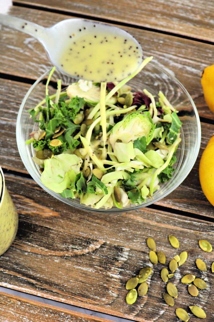 Delicious keto salad dressing - lemon poppyseed is tart, tangy, sweet and delicious on a low carb diet. Sugar-free and guilt-free. #ketodressing #sugarfreedressing #ketorecipes