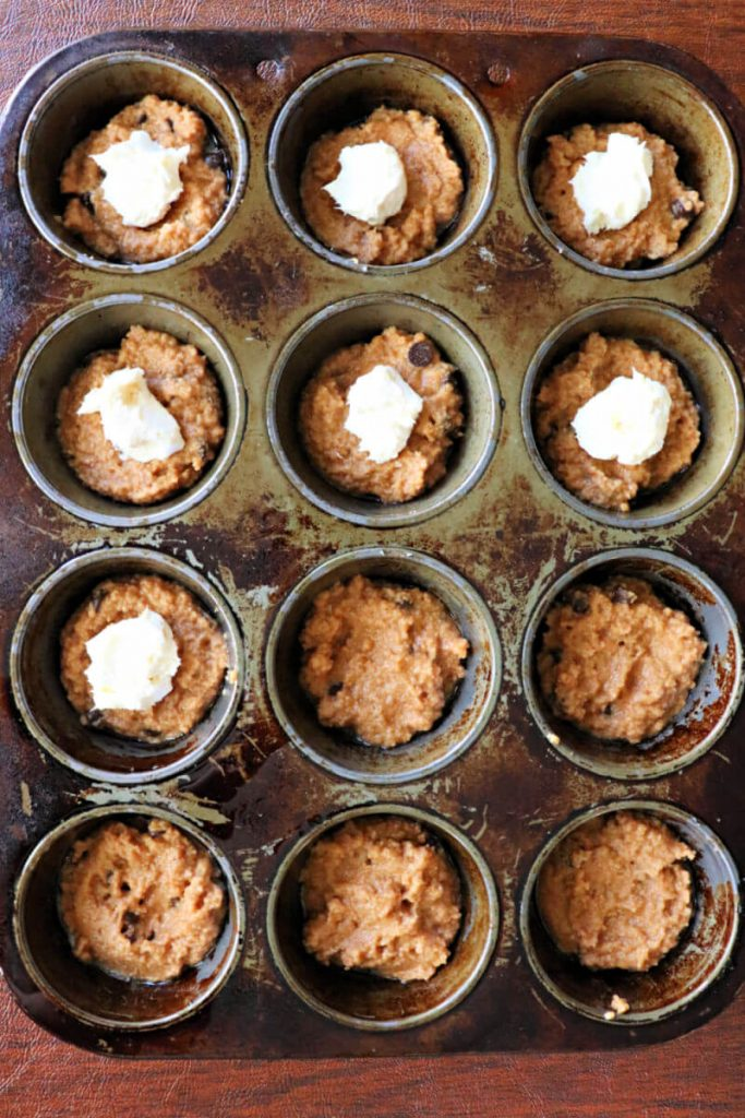 Cream cheese filling makes a divine keto pumpkin muffin! These low carb babies make a delicious grab-and-go sugar-free breakfast, perfect for fall or anytime! #ketorecipes #pumpkinspice #lowcarbpumpkin