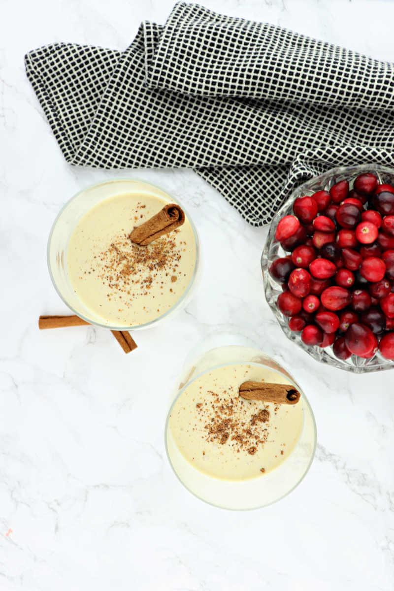 Two glasses of sugar-free eggnog with cinnamon and nutmeg. #ketorecipes #ketochristmas
