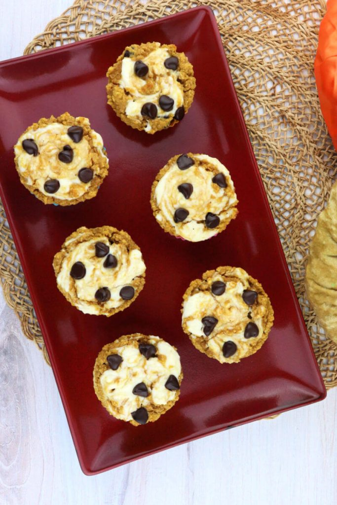 Overhead view of six keto pumpkin muffins on a plate