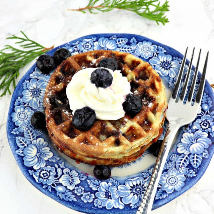 Blueberry chaffles are delicious and the perfect holiday keto breakfast! Low carb, sugar-free, but full of flavor and traditional flavors. #chaffles #ketochaffles #blueberry
