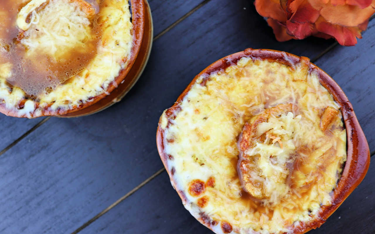 Keto French Onion Soup overhead with gruyere and garlic crostini #ketosouprecipes #ketorecipes #lowcarbsoup