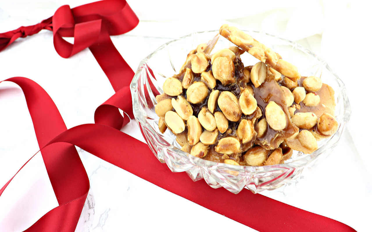 A holiday low carb candy reminiscent of childhood Christmases, keto peanut brittle is salty and sweet and delicious. #ketocandy #ketodesserts #lowcarbsnacks