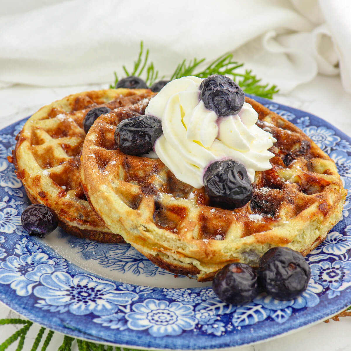 Delicious blueberry chaffles are a fabulous keto low carb breakfast! Gluten-free with classic blueberry morning flavor.