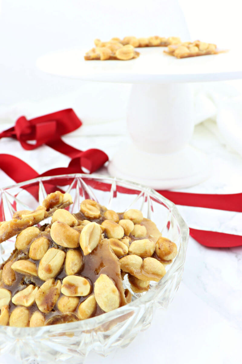 Easy keto peanut brittle will be a hit at your next low carb holiday party. Sugar-free and gluten-free with the taste of peanut salty sweet of childhood. #ketorecipes #lowcarbcandy #sugarfreepeanutbrittle