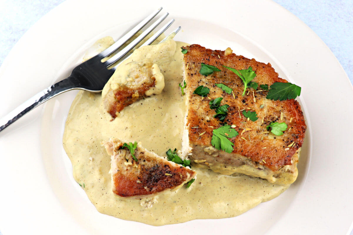 Low carb pork chops with keto gravy make the perfect keto family dinner. #familydinner #ketoporkchops
