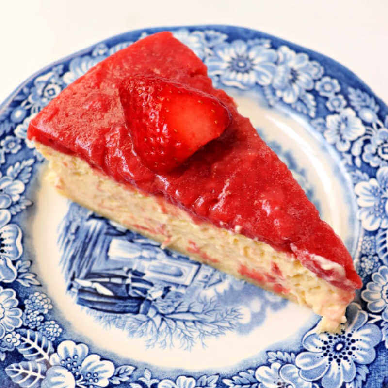 Piece of keto strawberry cheesecake on a plate. #ketocheesecake #ketodesserts #ketovalentine