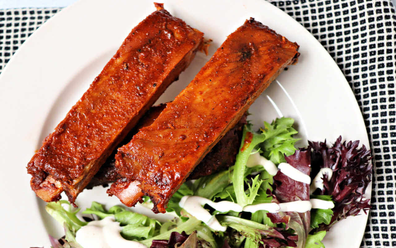 Low carb pork ribs with keto rib rub are a delicious blast to my southern past. Southern-style gluten-free spices with ooey-gooey pork joy. #ketorecipes #ketodinners #lowcarbribs