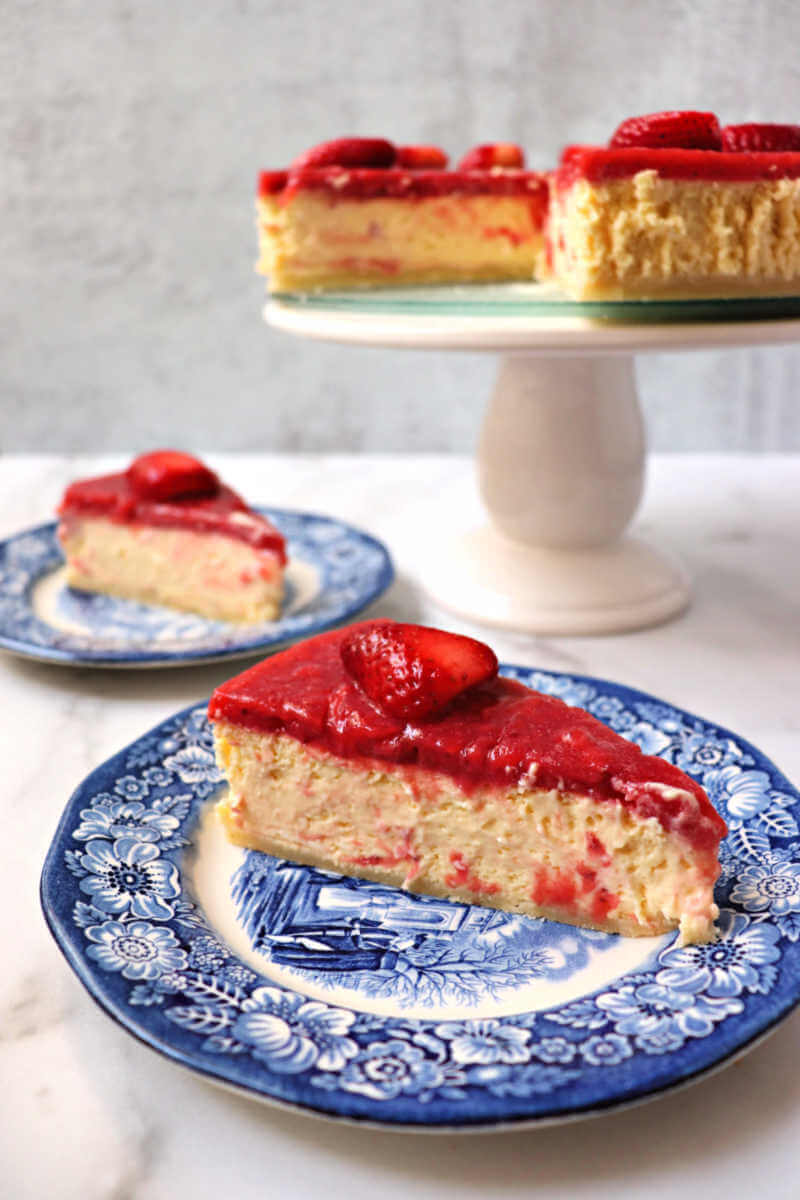 Creamy keto strawberry cheesecake is perfect for Valentine's Day or any special event. A low carb almond flour crust, then silky-smooth keto cheesecake, with a sugar-free strawberry topping. #ketocheesecake #ketodessert #ketolicious