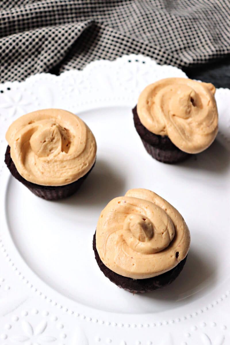 Overhead keto peanut butter frosting on gluten-free chocolate cupcakes. #ketofrosting #ketorecipes #ketodesserts