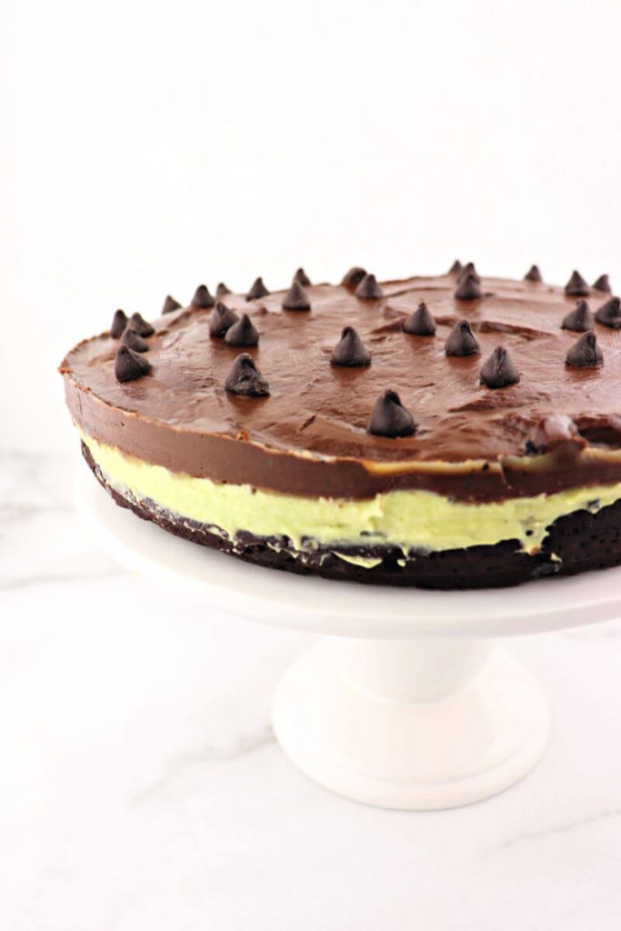 Keto flourless chocolate grasshopper cake pairs divinely rich dark chocolate with a sugar-free creamy mint filling naturally colored with avocado. The ideal low carb dessert for St. Patrick's Day or any holiday. #ketodessert #ketocake