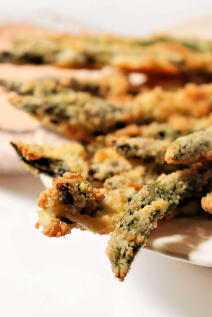 Keto asparagus fries are baked and perfect dipped in a spicy lemon garlic dip.