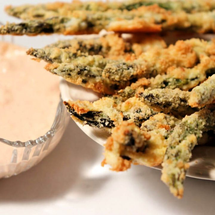 Keto asparagus fries are baked and delicious with spicy garlic dip. #ketoasparagus #ketosides