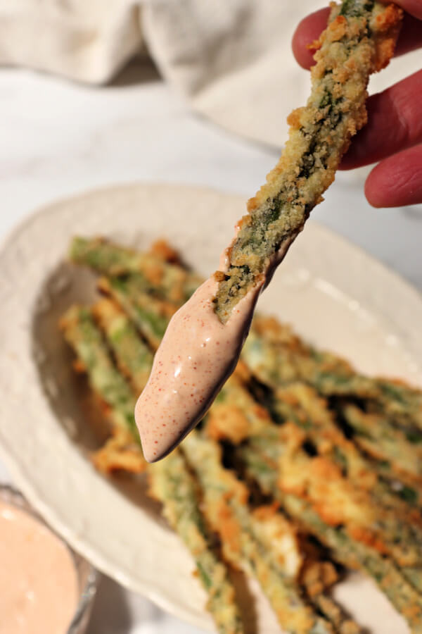 Keto asparagus fry dipped in spicy low carb garlic dip.