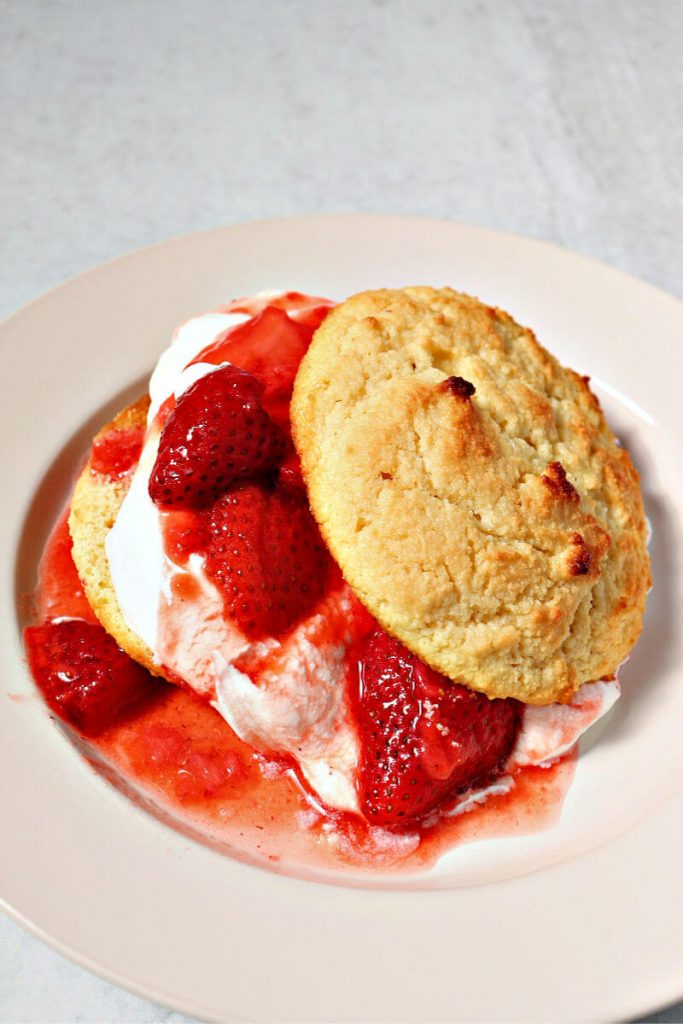 Keto strawberry shortcake is real food yum. Gluten-free biscuit with homemade whipped cream and strawberries. #ketorecipes #ketodesserts