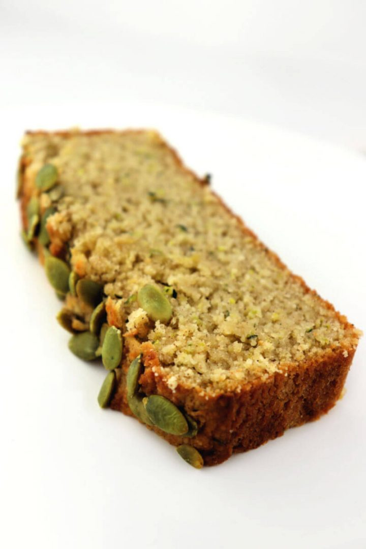 One piece of the best ever keto zucchini bread. Low carb, gluten-free, sugar-free delicious.
