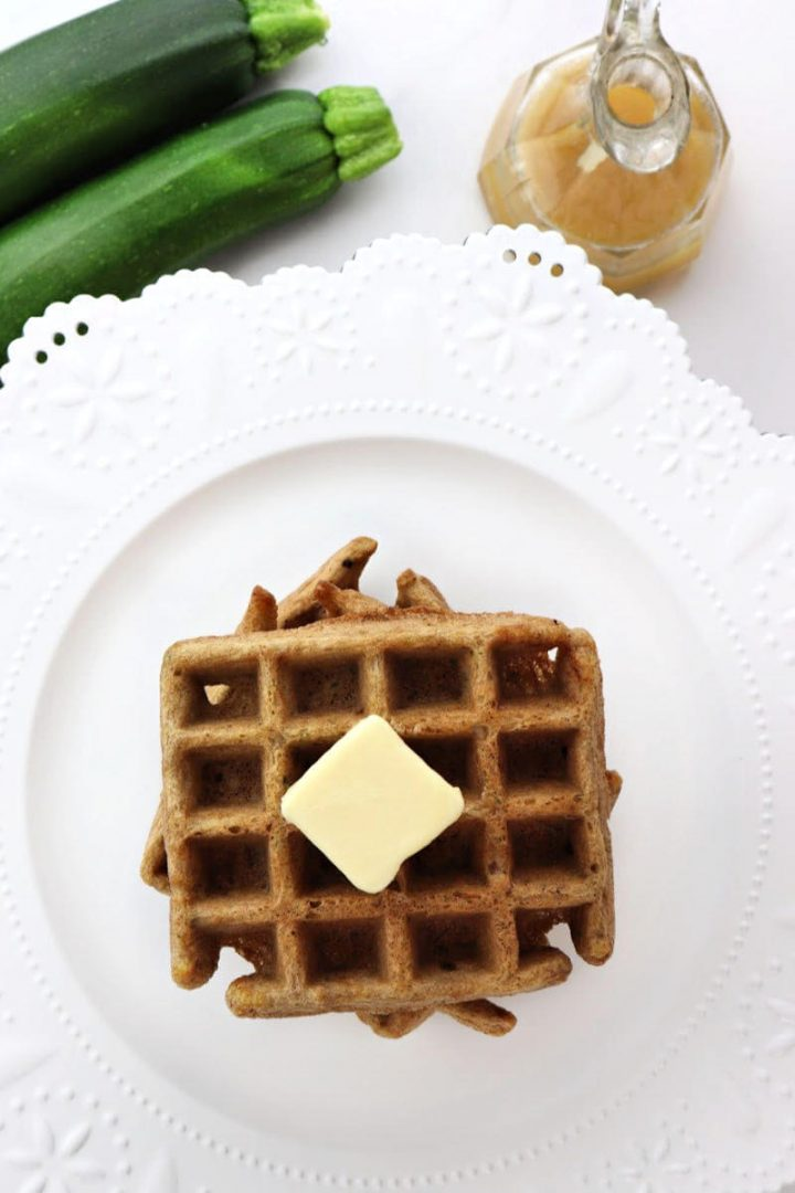Overhead keto zucchini waffles with zucchini and syrup