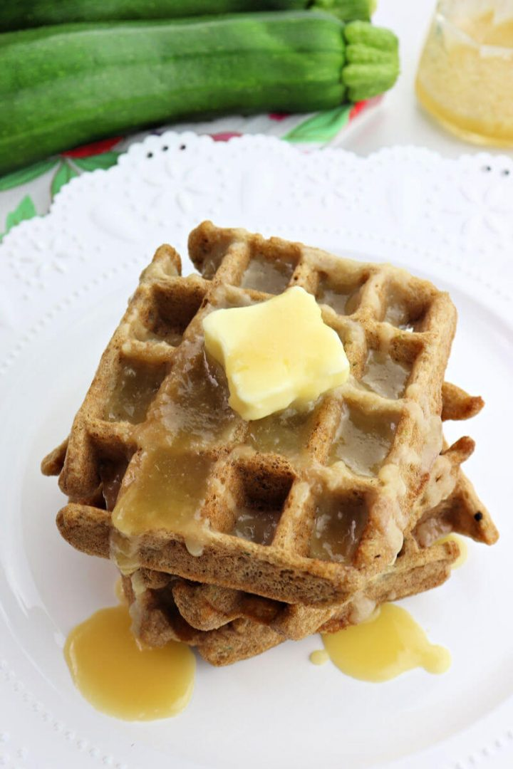 Stack of keto zucchini waffles with butter