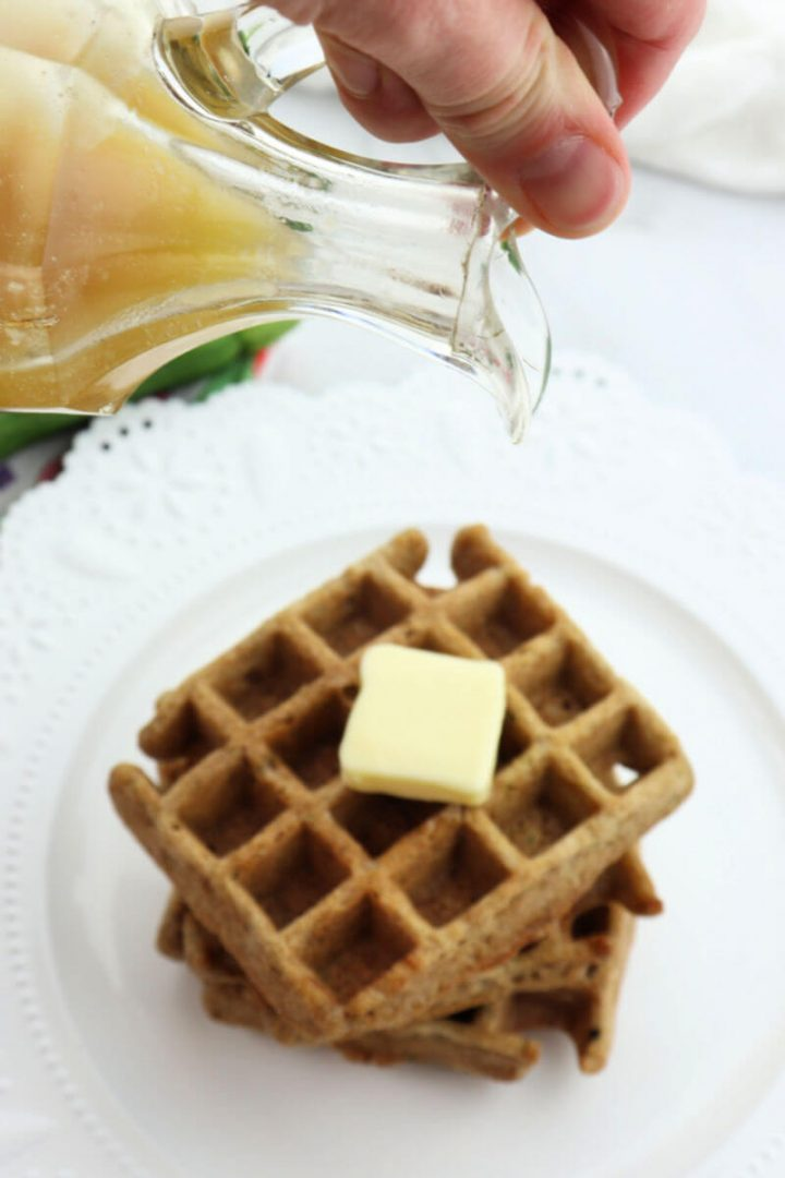 About to pour keto syrup over zucchini waffles