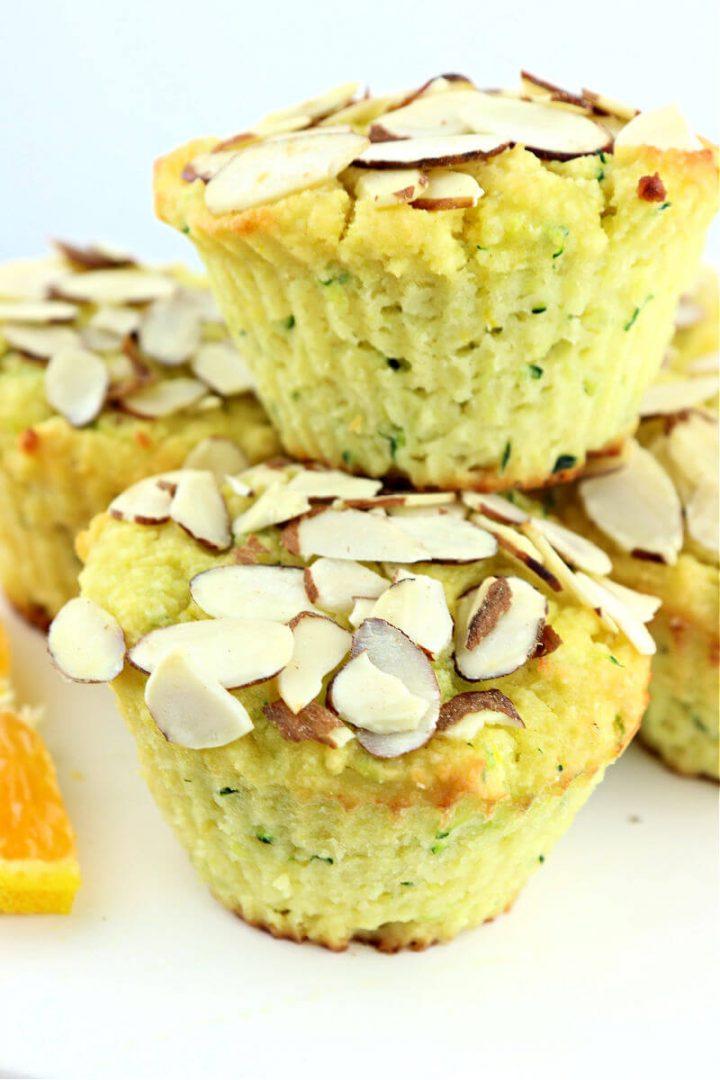 Stack of orange almond keto zucchini muffins