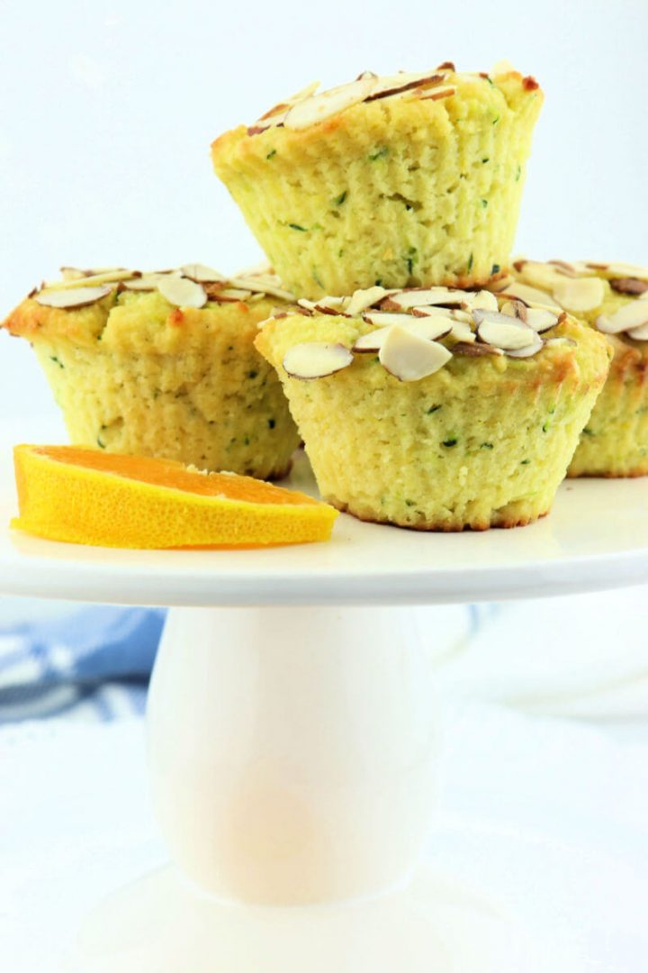Easy keto zucchini muffins on a pedestal with orange