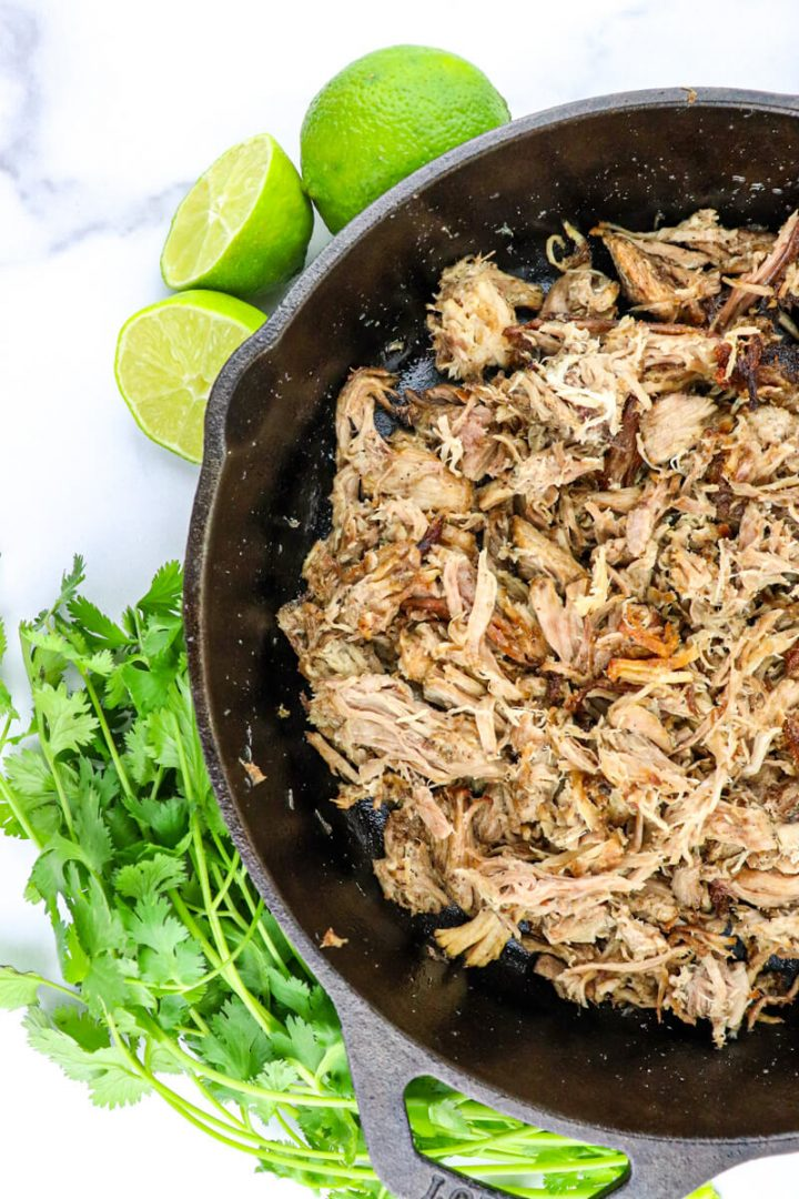 Overhead cast-iron pan of keto carnitas