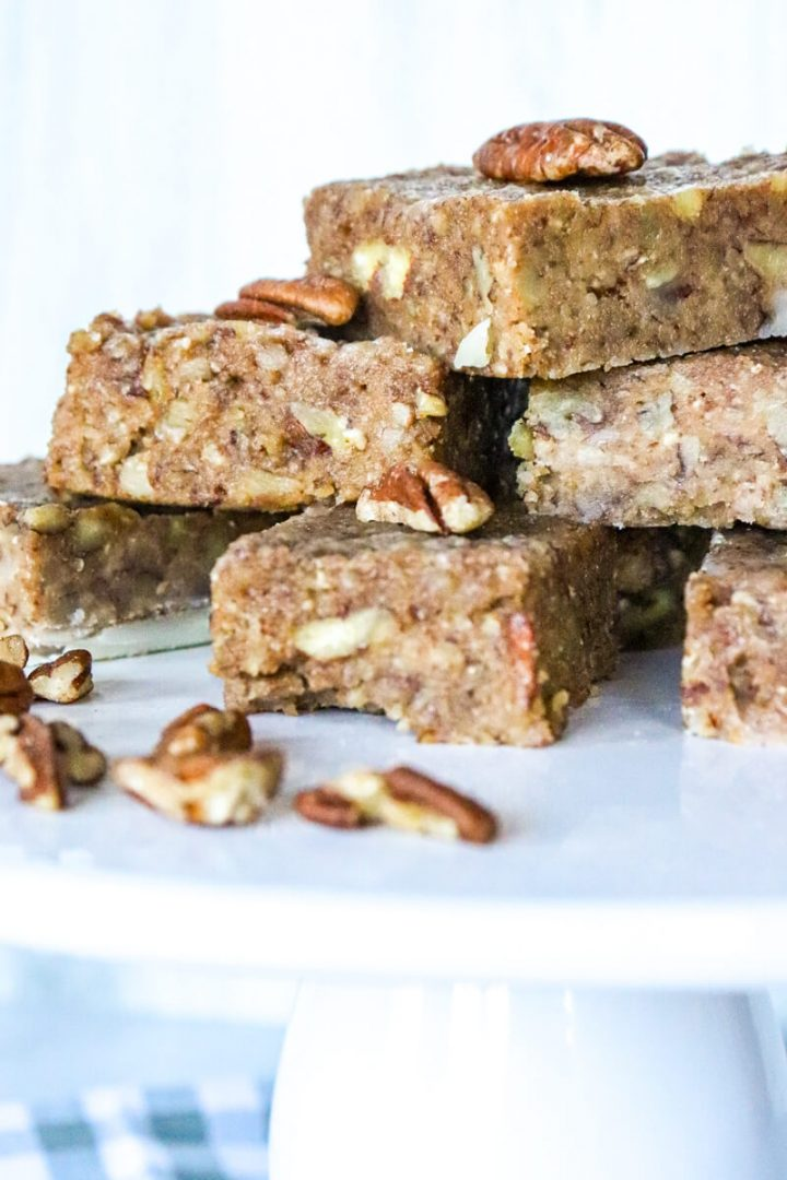 Side view of a stack of keto pecan pie bars