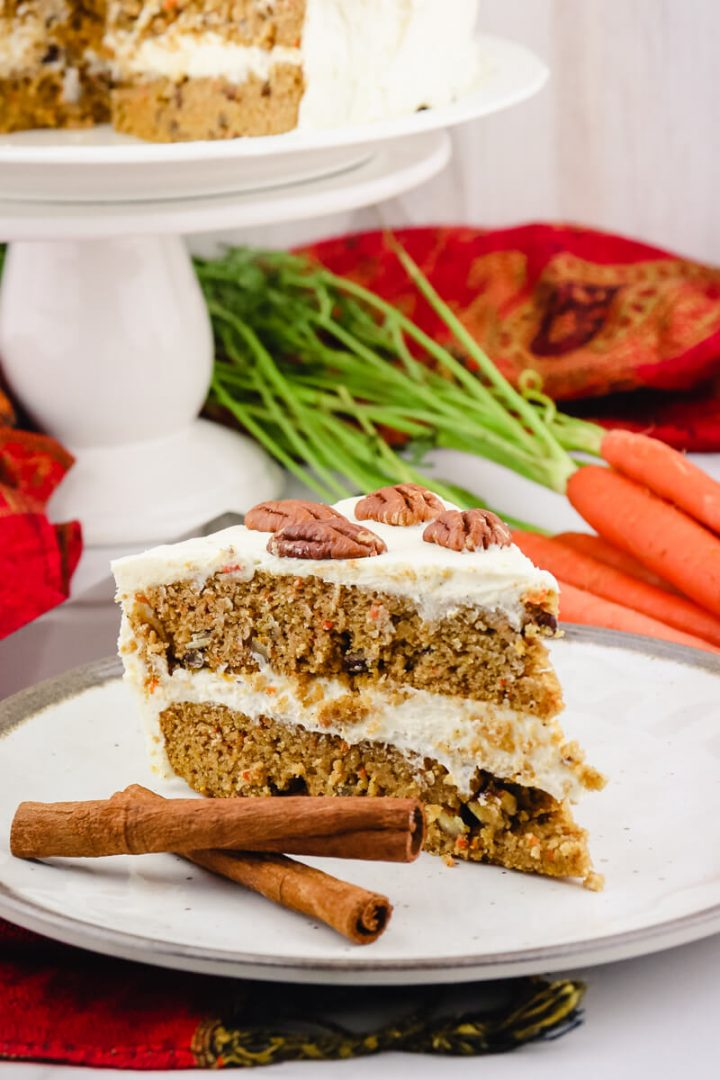 Piece of spiced keto carrot cake on a white plate