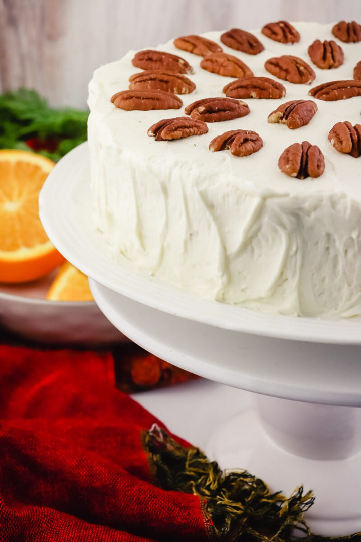 Keto carrot cake with pecans on a pedestal