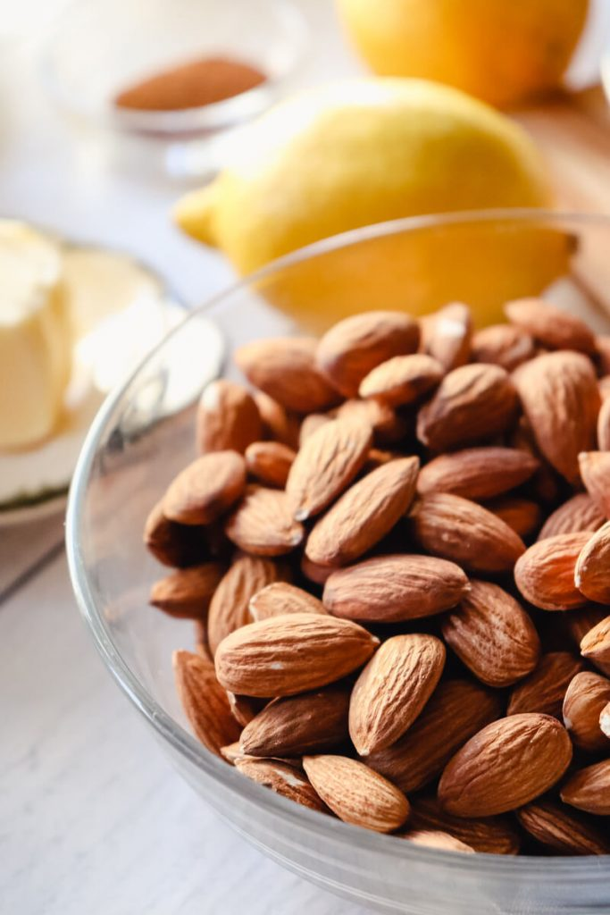 A bowl of almonds and a lemon