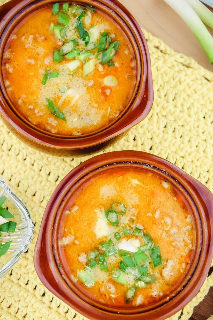 Overhead two bowls of keto hot and sour soup with pork