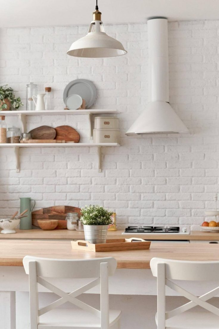 white kitchen with table and chairs