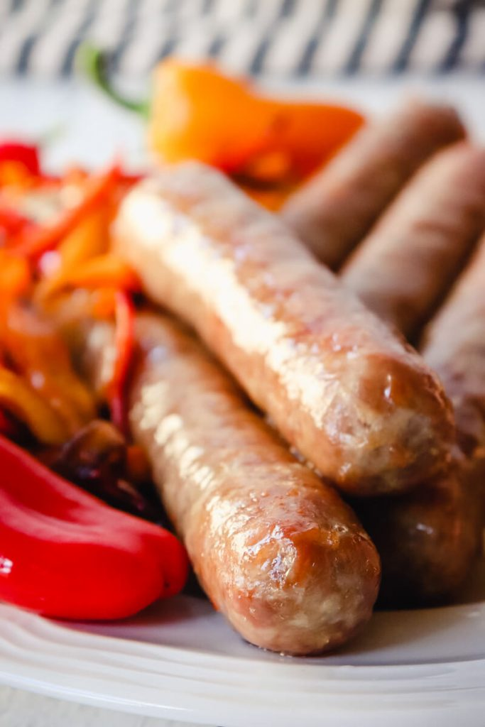 Close-up brats in air fryer on a plate