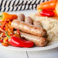 Brats in air fryer on a plate