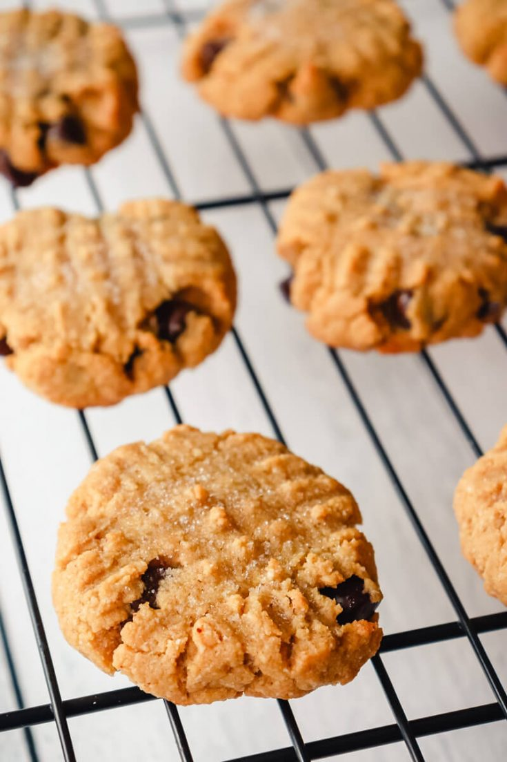 Keto peanut butter chocolate chip cookies on a wire rack